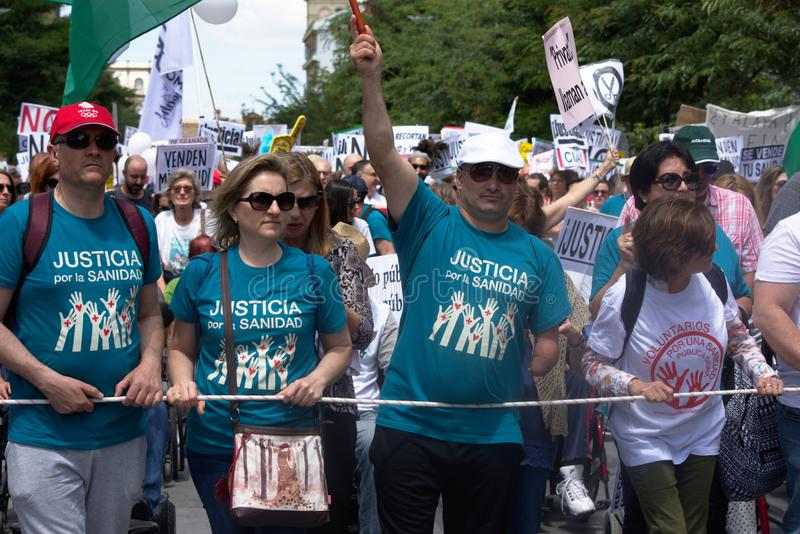 Demonstration in behalf of the Public Health Service 42. This is demonstration in Seville in behalf of the National Health Service and in behalf of a public royalty free stock images