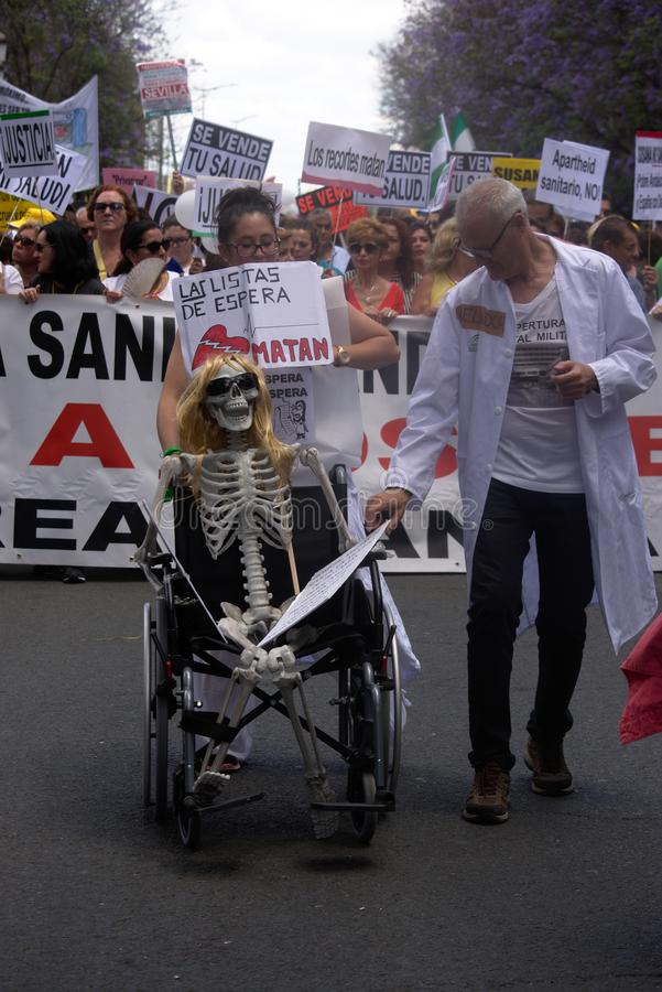 Demonstration in behalf of the Public Health Service 54. This is demonstration in Seville in behalf of the National Health Service and in behalf of a public royalty free stock photography