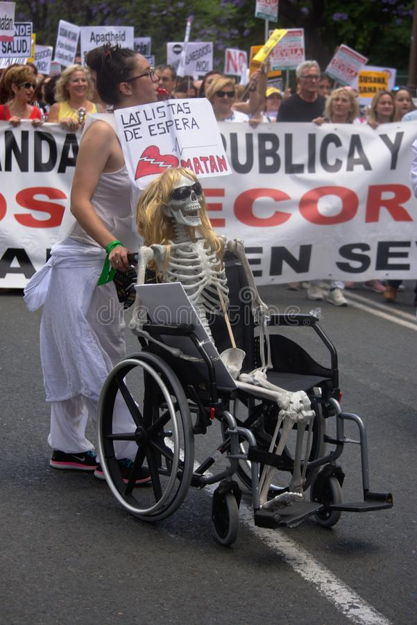 Demonstration in behalf of the Public Health Service 56. This is demonstration in Seville in behalf of the National Health Service and in behalf of a public royalty free stock photos