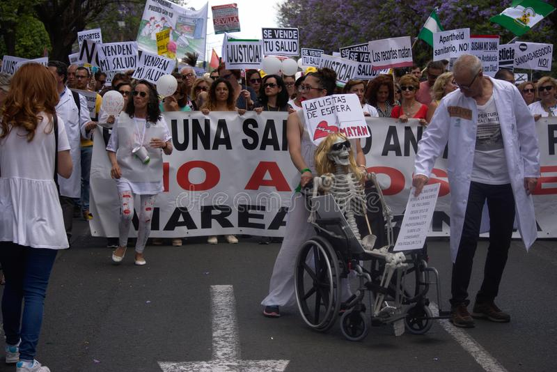 Demonstration in behalf of the Public Health Service 57. This is demonstration in Seville in behalf of the National Health Service and in behalf of a public stock image