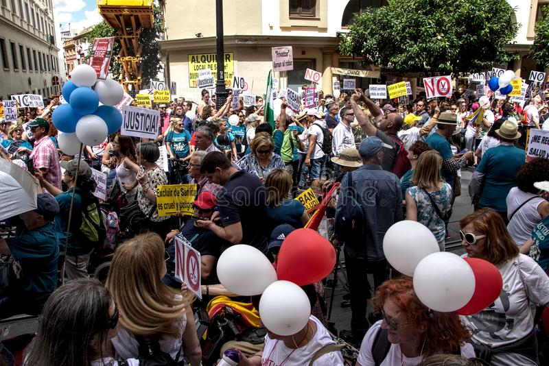 Demonstration in behalf of the Public Health Service 230. This is demonstration in Seville in behalf of the National Health Service and in behalf of a public royalty free stock images