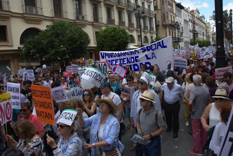 Demonstration in behalf of the Public Health Service 31. This is demonstration in Seville in behalf of the National Health Service and in behalf of a public royalty free stock photography