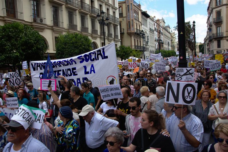 Demonstration in behalf of the Public Health Service 32. This is demonstration in Seville in behalf of the National Health Service and in behalf of a public stock photos