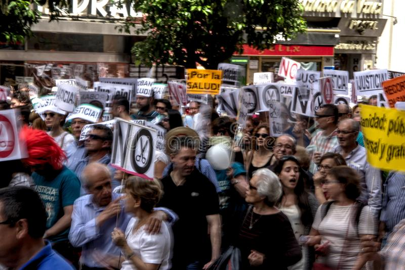 Demonstration in behalf of the Public Health Service 41. This is demonstration in Seville in behalf of the National Health Service and in behalf of a public royalty free stock images
