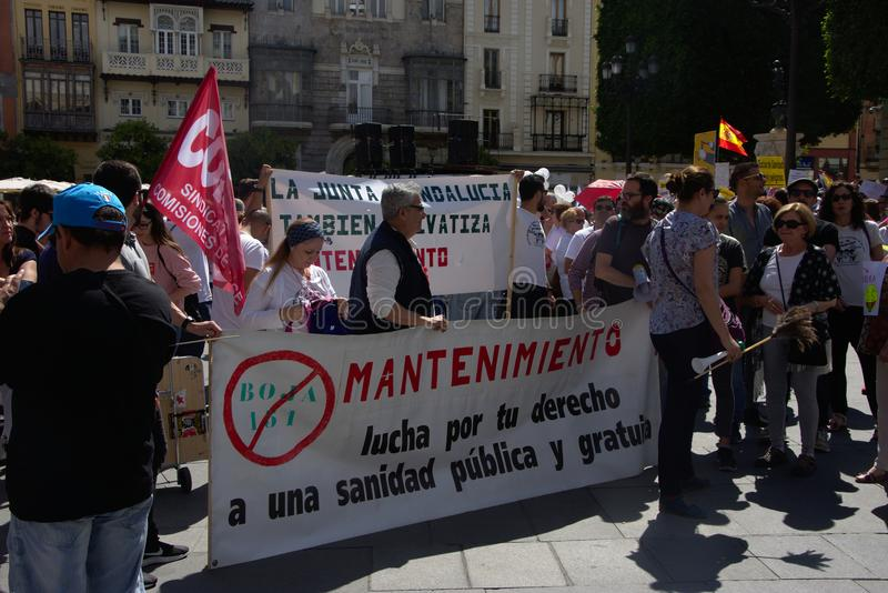 Demonstration in behalf of the Public Health Service 1. This is demonstration in Seville in behalf of the National Health Service and in behalf of a puclic stock images