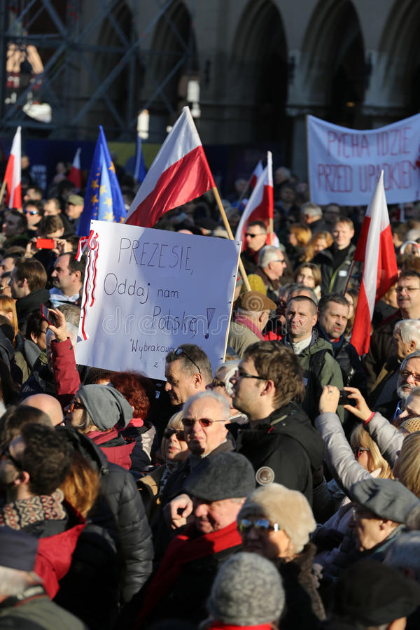 The demonstration of the Committee of Protection of the Democracy /KOD/. CRACOW, POLAND - DECEMBER 19, 2015: Cracow, Main Square - The demonstration of the royalty free stock photos