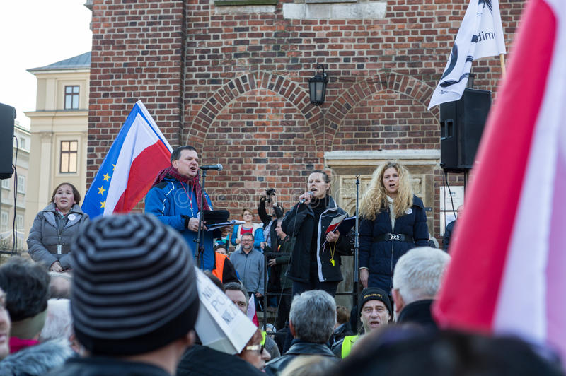 The demonstration of the Committee of Protection of the Democracy /KOD/. CRACOW, POLAND - DECEMBER 19, 2015: Cracow, Main Square - The demonstration of the royalty free stock photography