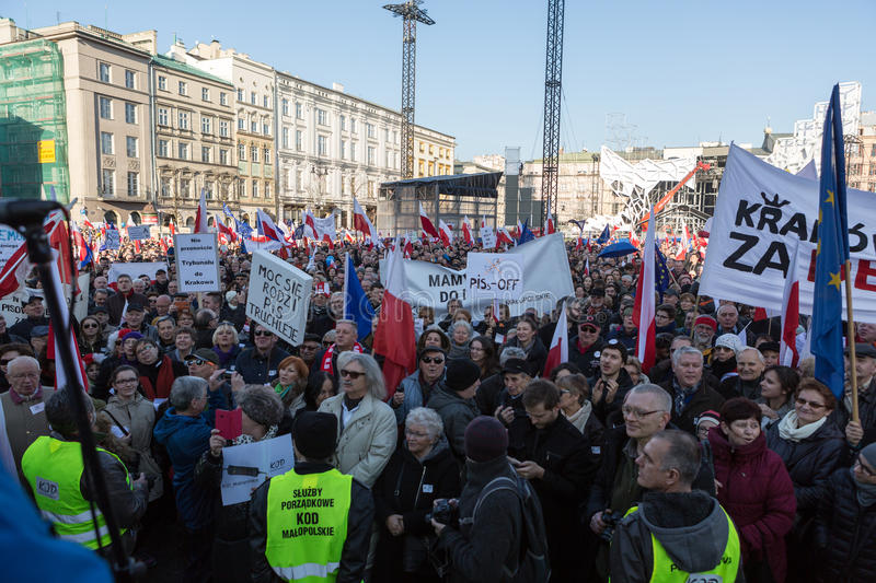The demonstration of the Committee of Protection of the Democracy /KOD/. CRACOW, POLAND - DECEMBER 19, 2015: Cracow, Main Square - The demonstration of the stock photos