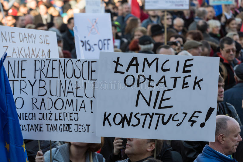 The demonstration of the Committee of Protection of the Democracy /KOD/. CRACOW, POLAND - DECEMBER 19, 2015: Cracow, Main Square - The demonstration of the royalty free stock photo