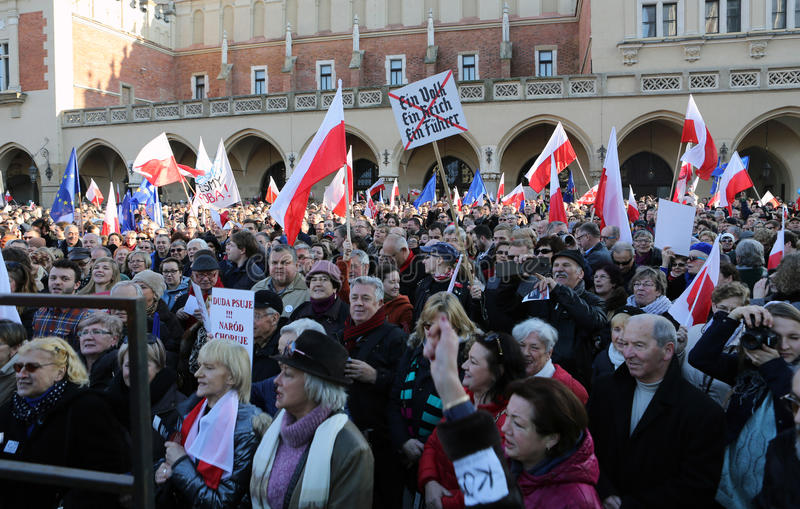 The demonstration of the Committee of Protection of the Democracy /KOD/. CRACOW, POLAND - DECEMBER 19, 2015: Cracow, Main Square - The demonstration of the royalty free stock images
