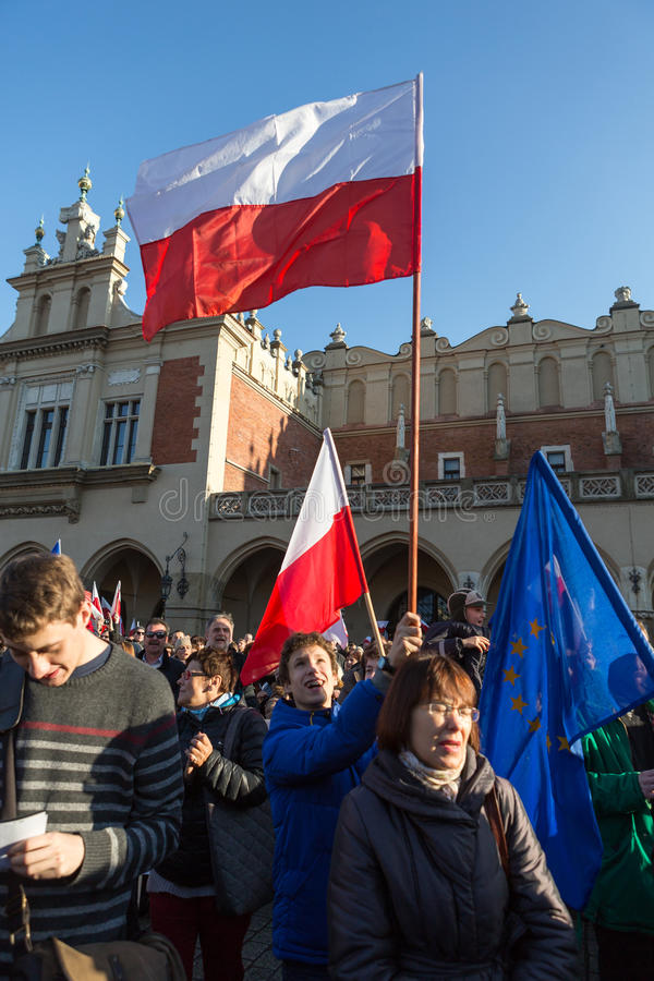 The demonstration of the Committee of Protection of the Democracy /KOD/. CRACOW, POLAND - DECEMBER 19, 2015: Cracow, Main Square - The demonstration of the stock photography