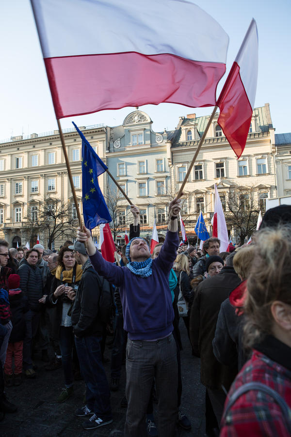 The demonstration of the Committee of Protection of the Democracy /KOD/. CRACOW, POLAND - DECEMBER 19, 2015: Cracow, Main Square - The demonstration of the royalty free stock image