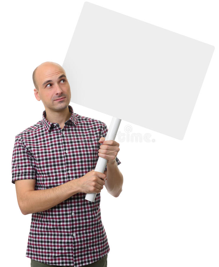 Demonstration concept. Man holding a blank poster. With text area. Isolated stock photo