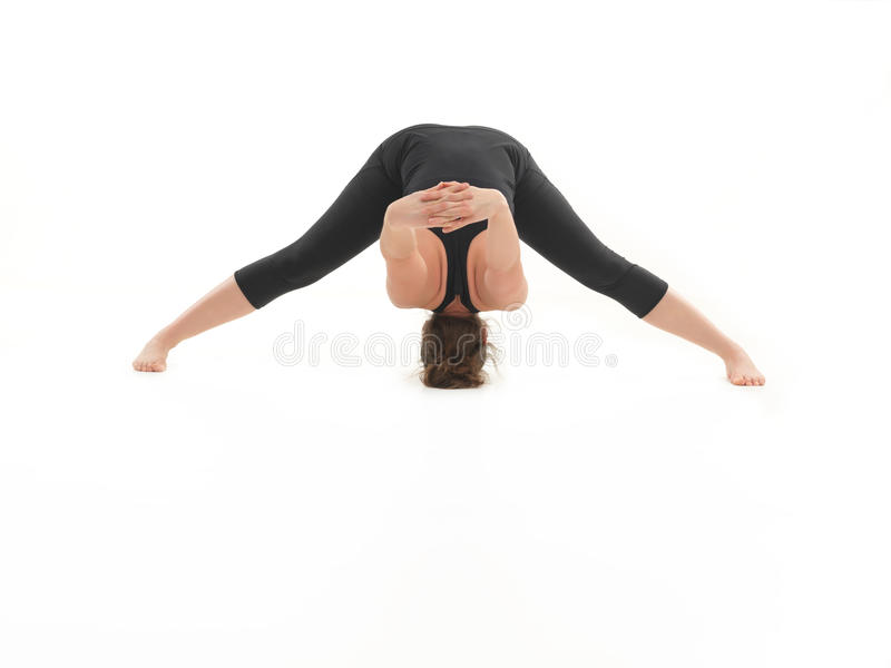 Demonstration of difficult stretching yoga pose stock photos