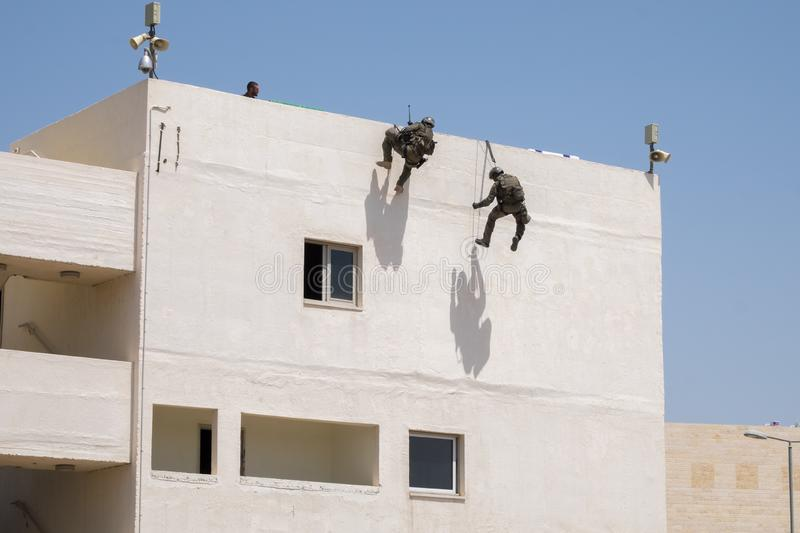 Demonstration of Israel Police Special Unit storming home with terrorists stock image