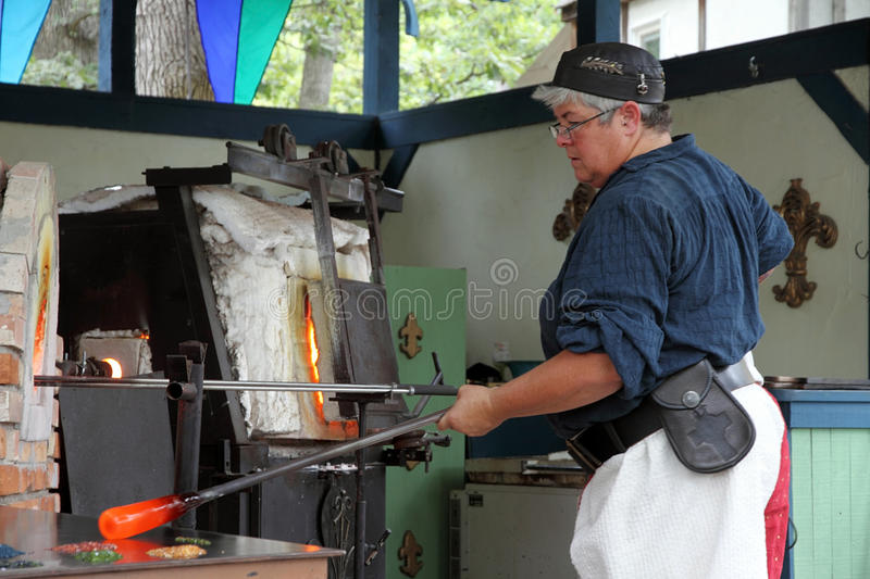 Demonstration of making a cup from a molten glass. KENOSHA, WI - SEPTEMBER 4: Demonstration of making a cup from a molten glass at the annual Bristol Renaissance stock images