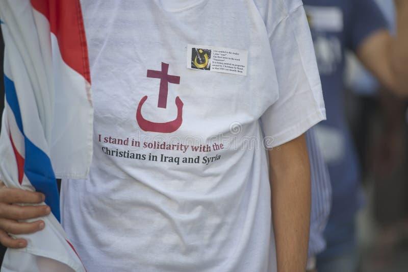 Demonstration mot förföljelser och grymheter i Irak royaltyfria bilder