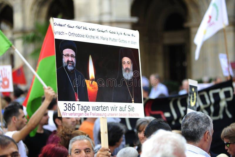 Demonstration mot förföljelser och grymheter i Irak royaltyfri bild
