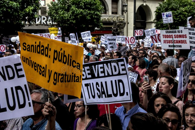Demonstration in behalf of the Public Health Service 36. This is demonstration in Seville in behalf of the National Health Service and in behalf of a public royalty free stock images