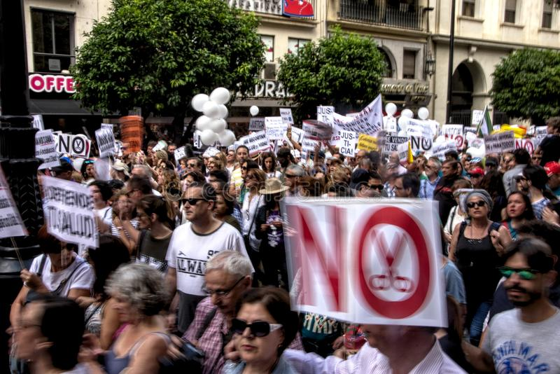 Demonstration in behalf of the Public Health Service 37. This is demonstration in Seville in behalf of the National Health Service and in behalf of a public stock photos