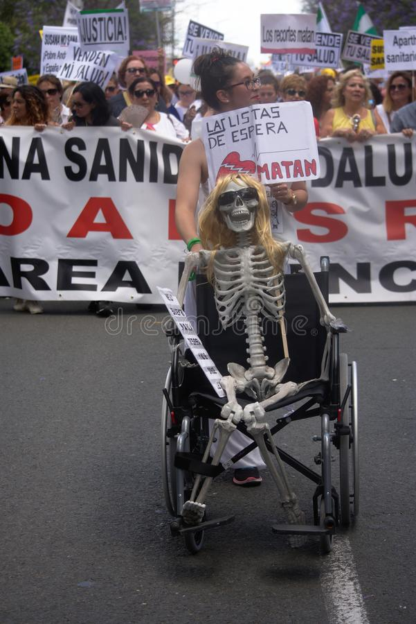 Demonstration in behalf of the Public Health Service 55. This is demonstration in Seville in behalf of the National Health Service and in behalf of a public royalty free stock photos