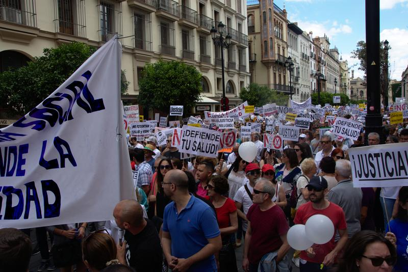 Demonstration in behalf of the Public Health Service 33. This is demonstration in Seville in behalf of the National Health Service and in behalf of a public royalty free stock image