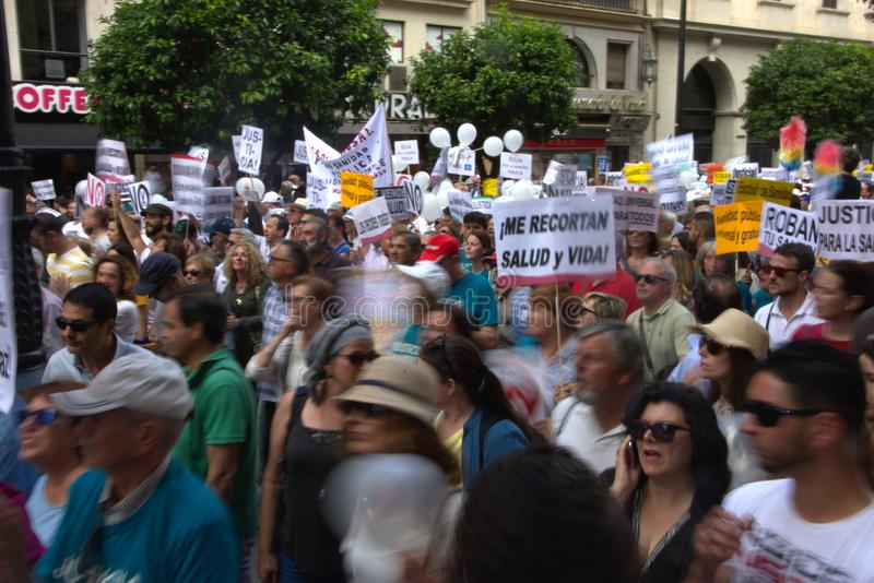 Demonstration in behalf of the Public Health Service 38. This is demonstration in Seville in behalf of the National Health Service and in behalf of a public royalty free stock images