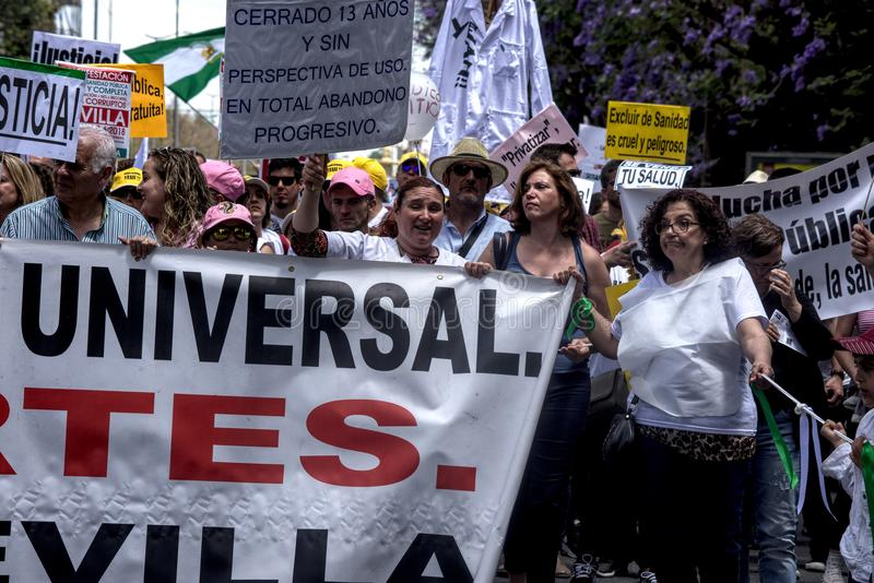 Demonstration in behalf of the Public Health Service 53. This is demonstration in Seville in behalf of the National Health Service and in behalf of a public royalty free stock photography