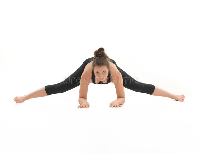 Demonstration of stretching yoga pose stock images