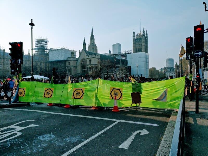 Demonstrationer London UK för utplåningrevoltprotest fotografering för bildbyråer