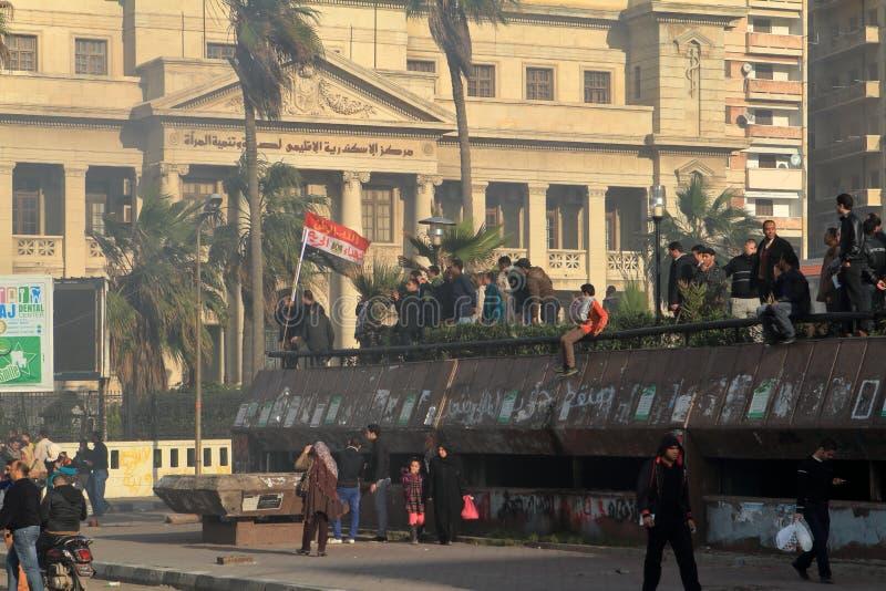 Demonstrationer och brinnande bilar i Alexandria royaltyfri bild