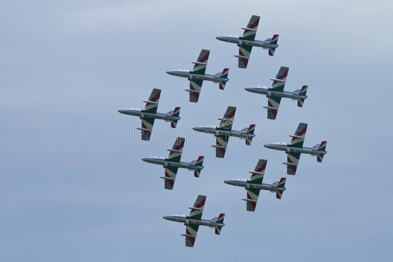 Demonstrative performance of aerobatic team. Frecce Tricolori (Italian, literally Tricolour Arrows), is the aerobatic demonstration team of the Italian royalty free stock image
