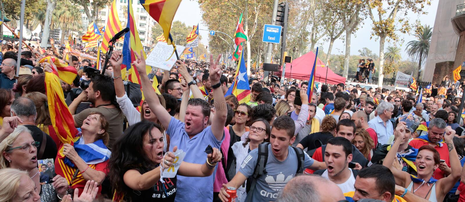 Demonstrators celebrating after the declaration of independence of catalonia in central barcelona royalty free stock image