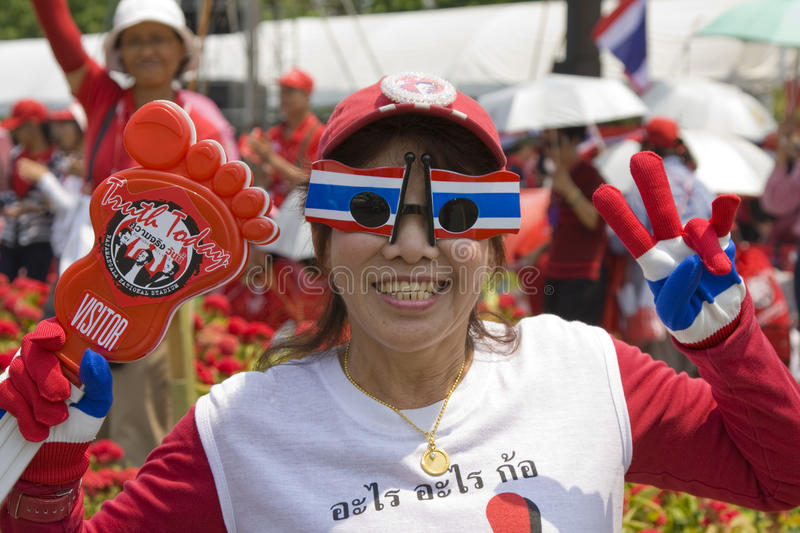 Demonstrators converged on the Thai capital. BANGKOK , THAILAND - MARCH 13: Thousands of red-shirted, anti-government demonstrators converged on the Thai capital royalty free stock photography