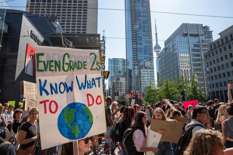 Climate Strike Toronto Demonstrators March Through Downtown. Demonstrators march through downtown Toronto, Ontario during the Climate Strike on September 27 stock photography