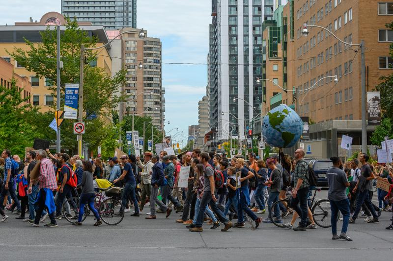 Climate Strike Toronto Demonstrators March Through Downtown. Demonstrators march through downtown Toronto, Ontario during the Climate Strike on September 27 stock photo