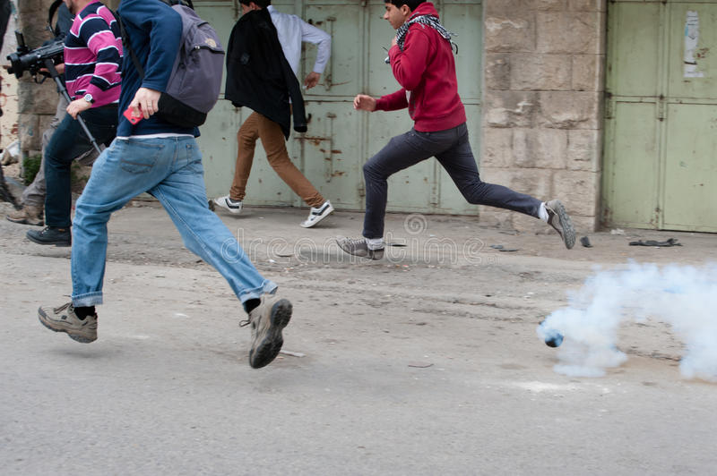 Demonstrators and tear gas royalty free stock photo