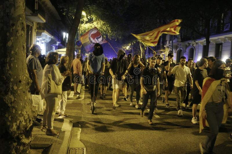 Demonstrators walk the streets of Barcelona cutting traffic stock images