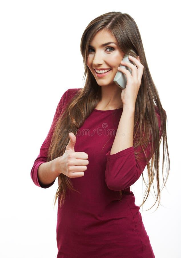 Demostración ascendente del pulgar modelo joven femenino foto de archivo libre de regalías