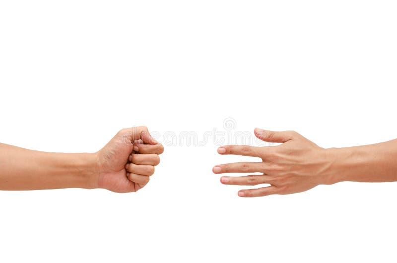 Demostración de la mano del hombre un piedra papel o tijera del juego foto de archivo libre de regalías