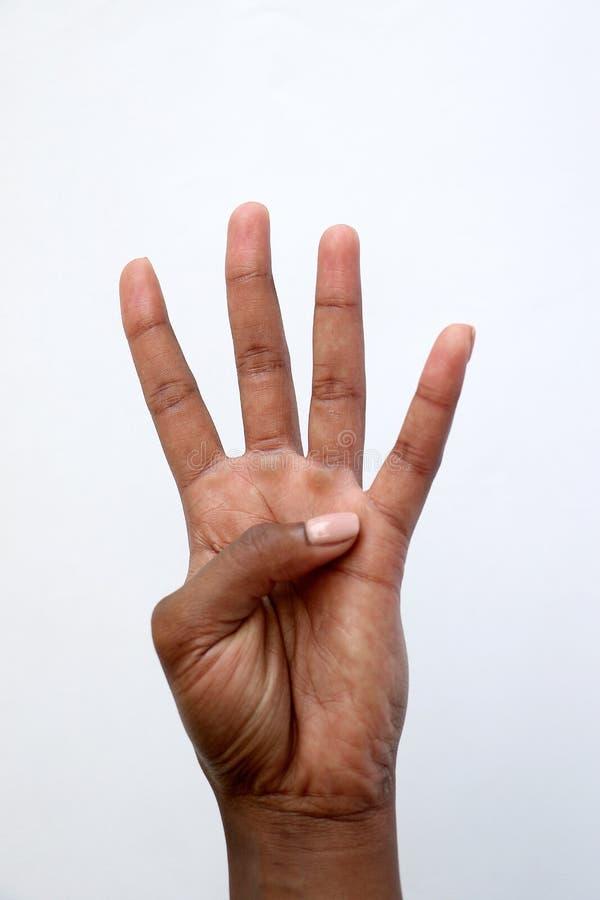 Demostración india africana negra número cuatro de la mano imagenes de archivo