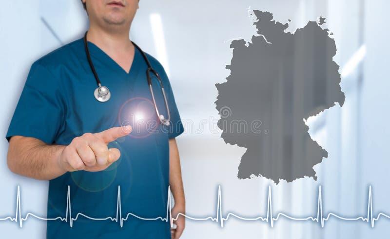 Demostraciones del doctor del mapa de Alemania en concepto del espectador foto de archivo libre de regalías