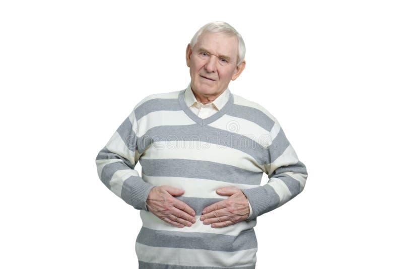 Den åldriga mannen med magen smärtar royaltyfri bild
