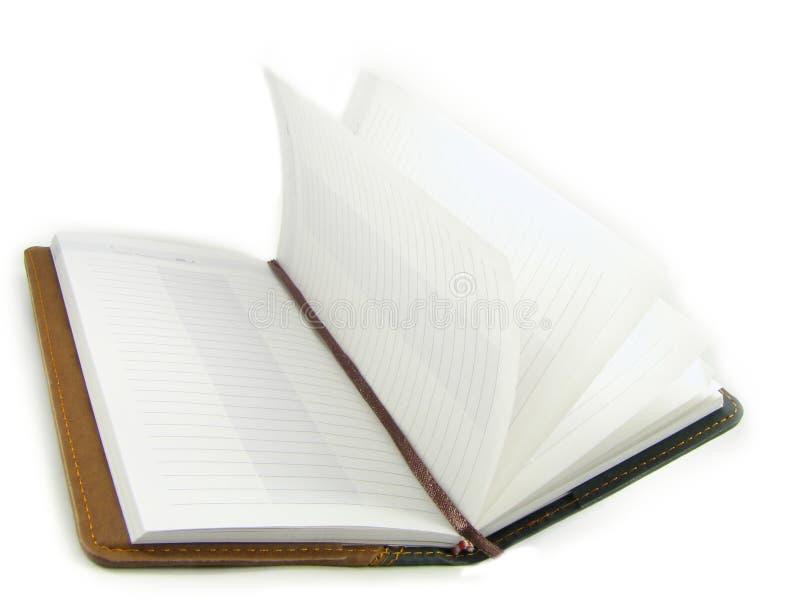Den öppna anteckningsboken. arkivfoto