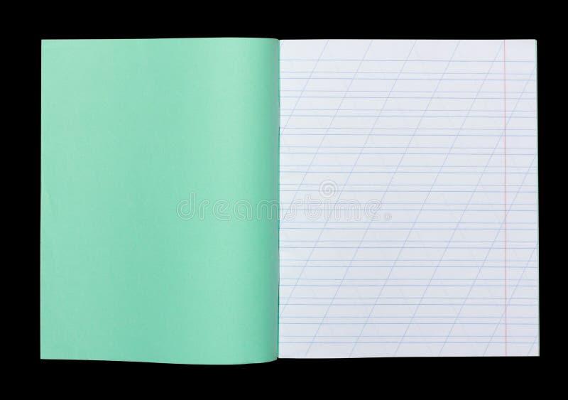 Den öppna skolaanteckningsboken i en smal linje med ett snedstreck för att lära stavning, förlöjligar upp med kopieringsutrymme s arkivbild