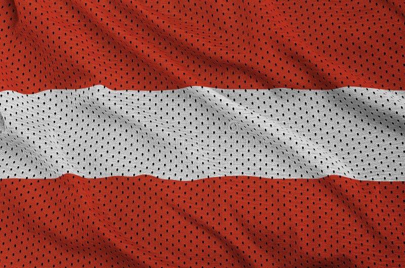 Den Österrike flaggan skrivev ut på ett tyg för ingrepp för polyesternylonsportswear royaltyfri bild