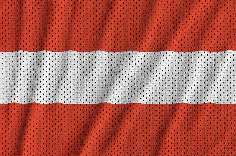 Den Österrike flaggan skrivev ut på ett tyg för ingrepp för polyesternylonsportswear royaltyfri fotografi
