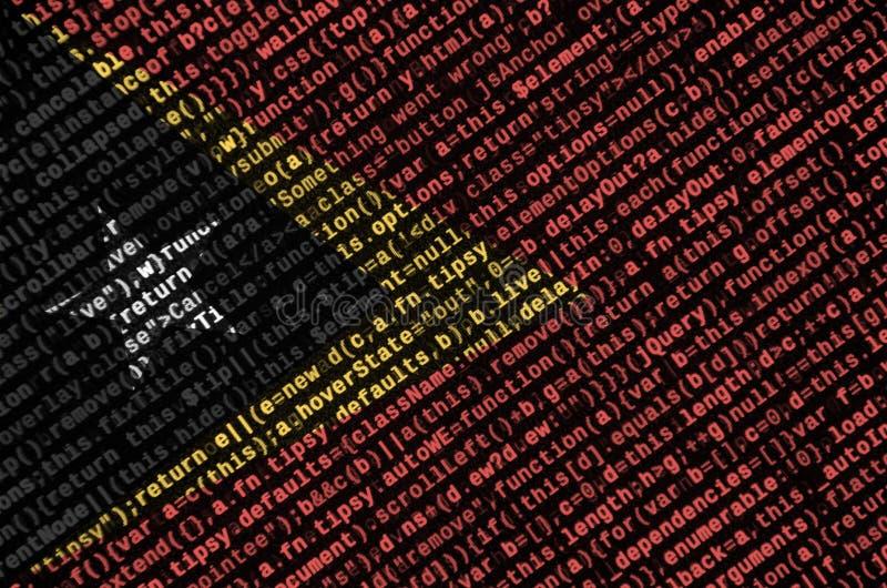 Den Östtimor flaggan visas på skärmen med programkoden Begreppet av modern teknologi- och platsutveckling arkivfoton