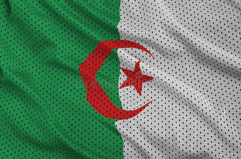 Den Algeriet flaggan skrivev ut på ett tyg för ingrepp för polyesternylonsportswear royaltyfri bild