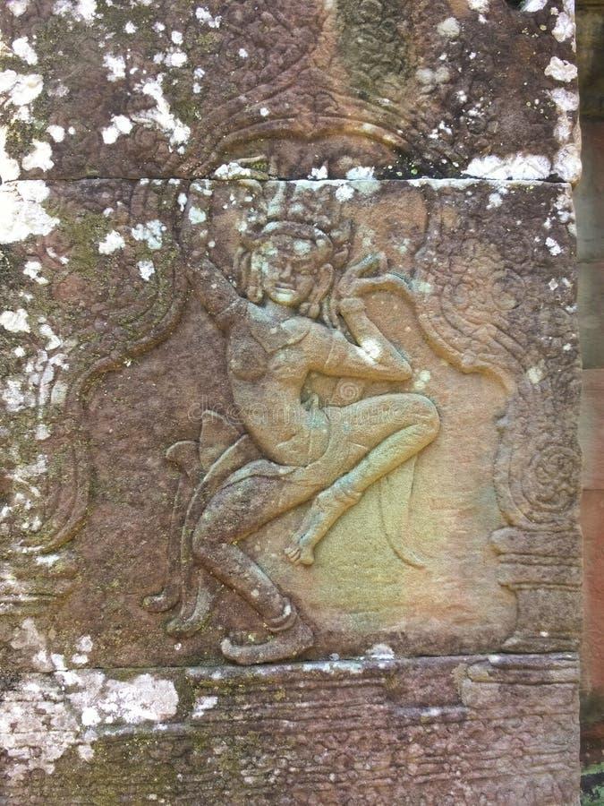 Den Apsara dansaren sned på väggen av den forntida templet för den Prasat Bayon en khmer Angkor Wat i Siem Reap, Cambodia royaltyfria foton